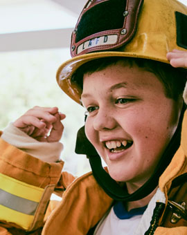 Boy in Firefighter Gear